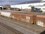 Rusty box car with locomotives