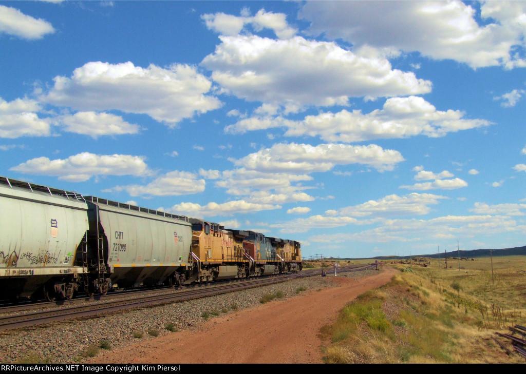 UP 7117 EB Covered Hopper Train on the Laramie Sub