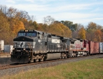 NS 9267 heads west with Santa Fe trailing