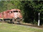 DME 6085 pulls a train