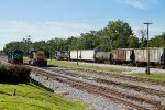CSX 7885 draws a cut of cars out of the yard