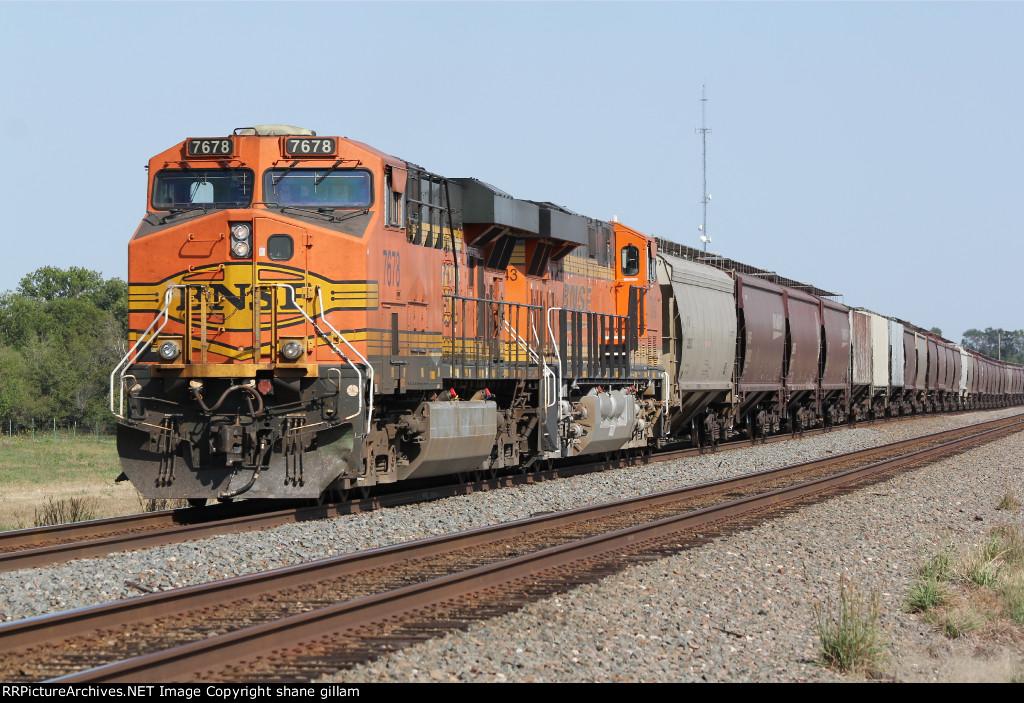 BNSF 7678 and 7043 work dpu on this eb grain train.