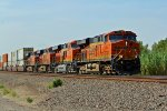 BNSF 7463 heads a Eb stack thur a small town in rural ks.