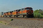 BNSF 1069 leads another Eb stack train thur small town usa.