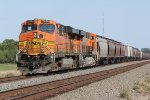 BNSF 7678 and 7043 work dpu on this eb grain train.