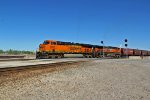 BNSF 6335 and 1007 leads a Sb grain train into Santa Fe junction.