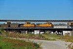 UP 7150 leads a Eb coal load over the flyover in kc,