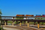 BNSF 7219 takes Wb stack on the flyover across Santa Fe Junction.