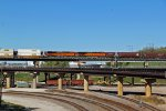 BNSF 6936 and bnsf 7686 runs dpu on a Wb stack train.