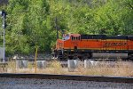 BNSF 7266 takes a grain train around the swing.