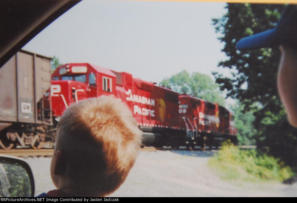 Kids watching railroad action.