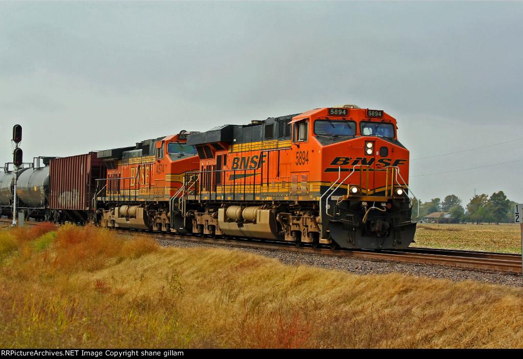 BNSF 5894 takes a oil train at tk speed NB.