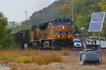 UP 5871 rips a coal load SB past the small yard.
