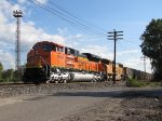 Freshly recrewed, BNSF 9064 leads E945 off the west end of the Service Track