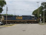 With D700 tied back together, CSX 7535 rolls east across the Broadway Ave crossing