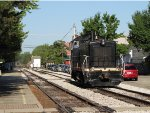 After shoving a couple cars east of the station, CPMY 7014 runs back west on the main