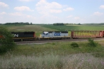 CSX 8387 is the trailing unit on M34191-11 at Nelsons Siding by Amherst, WI.