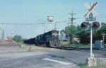 A westbound hopper train rolling through Burke