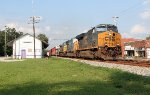 SB freight going by the silver & purple depot