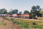 BNSF 1100, BNSF 4700 and one unidentified sister