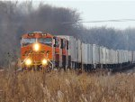 WB Z train doing every bit of 70mph through Coal City Ill with BN 7856 leading