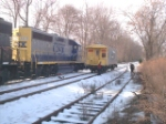 CSX 4412 leads its train on the runaround and passes caboose 21241