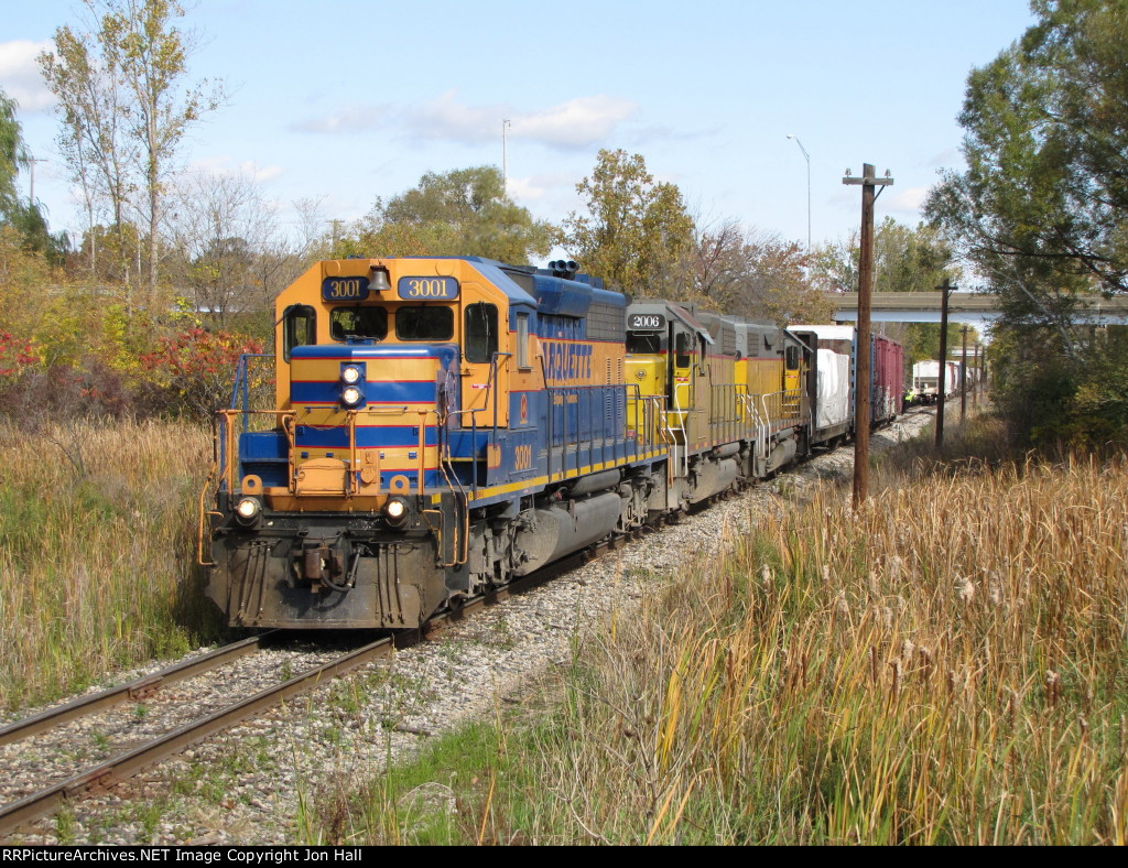 After cutting away from the train, 3001 leads Z151 down to switch Vans