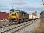 CSX 7334 & 5367 start east with the empty stone hoppers of K931