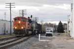 A signal worker stands back as N956-01 roars through the OS at Grandville