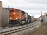 Just starting up the grade out of town, N956-01 heads uphill with 16,000 tons of coal in tow