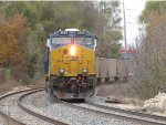 CSX 3062 heads away as D802 pushes N956 uphill