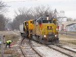 After backing out of the siding, the conductor reapplies the derail before 2004 heads south with the Harsco special