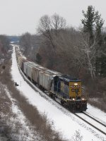 CSX 4034 leads D707-31 west into town with 46 cars mostly consisting of fertilizer empties
