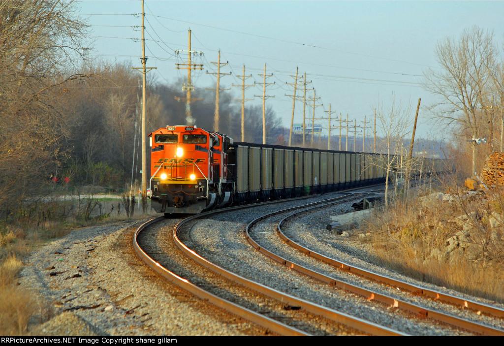BNSF 9313 Leads a SB loaded coal Around the mp curve.