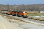 BNSF 5977 Heads Sb with a coal load On top a huge rock pile.