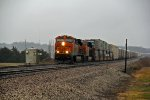 BNSF 7371 Eb into the rain.