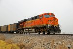 BNSF 5783 works dpu on a empty coal train.