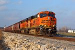 BNSF 7486 leads a Sb grain out of town.