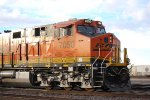 Close in Cab shot of BNSF 7050 as the setting sun shines off Her BNSF Swoosh Logo Paint.