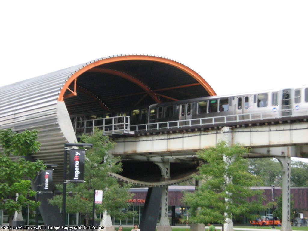 CTA Green Line Train passing through the IIT McCormick Tribune Campus Center Tube