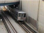 CTA Blue Line Train crossing under Milwaukee Avenue near Jefferson Park