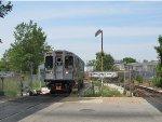 CTA Pink Line Train Preparing to Cross Kostner Avenue