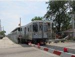 CTA Pink Line Train leaving the Kostner Station