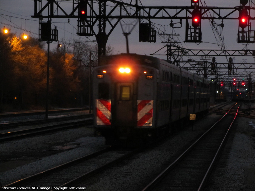 Metra Electric Train passing through the 63rd Street Junction at Sunset