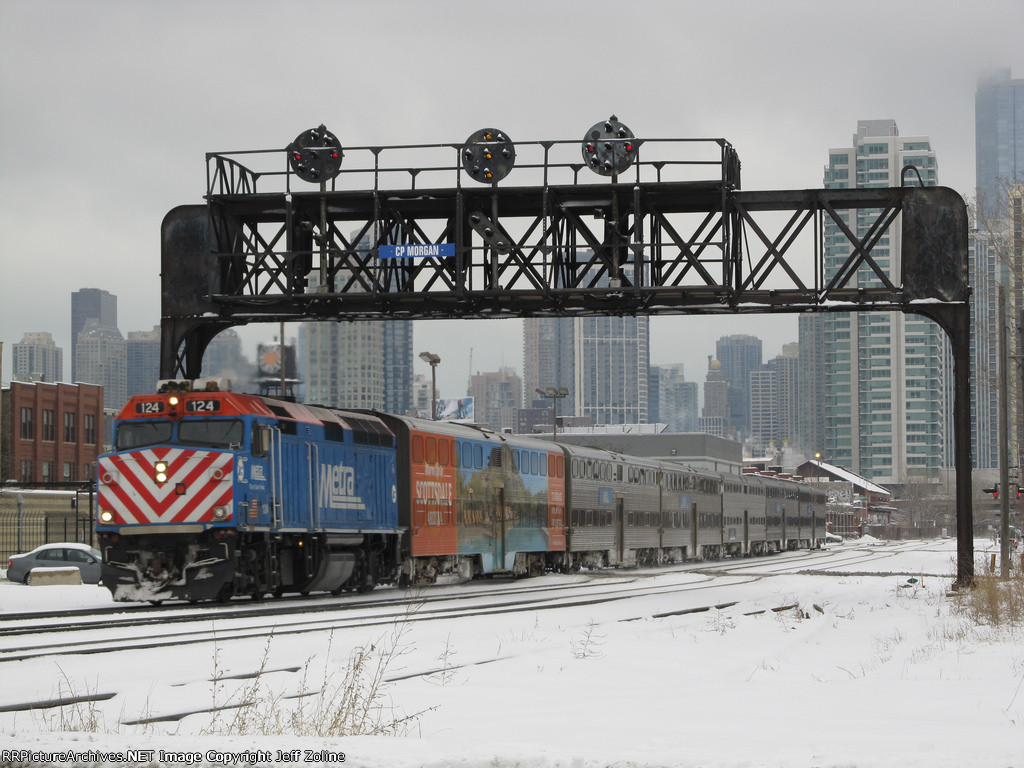 Metra Milwaukee District Train passing under the signals at Racine Avenue