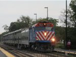 Metra UPN Train pulling the exclusive Club Car (Car 553)