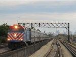 Metra UPW Train speeding through the West Side near Central Avenue