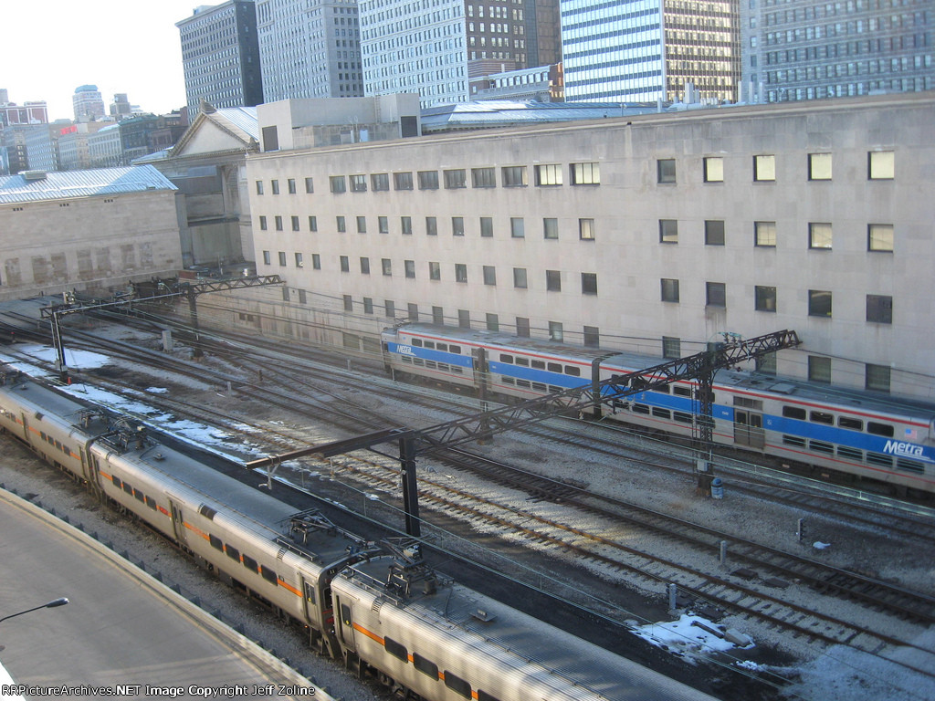 South Shore & Metra Electric Trains passing each other under the Art Institute