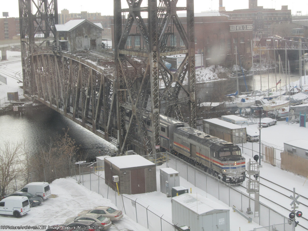 Amtrak Train Crossing the South Branch of the Chicago River along the Canal Street Railroad Bridge