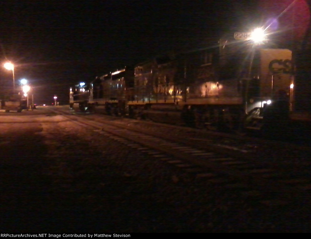 CSX 7777 CSX 6925 and CSX 2284 in the 18 degree night of Clarksburg, WV waiting on the signal westward